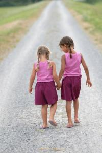 Little Girls walking down street high res istock
